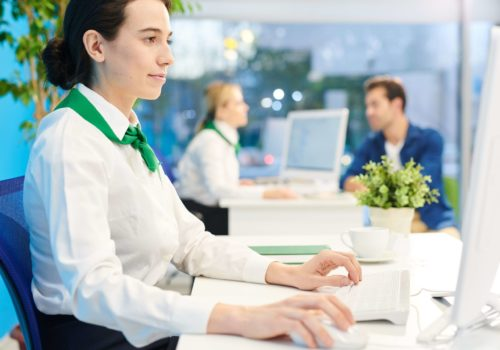 bank-manager-concentrated-on-work-PVDHLL9 (1)